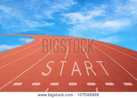 Outdoor Racetrack With Sign Start With Blue Sky Background