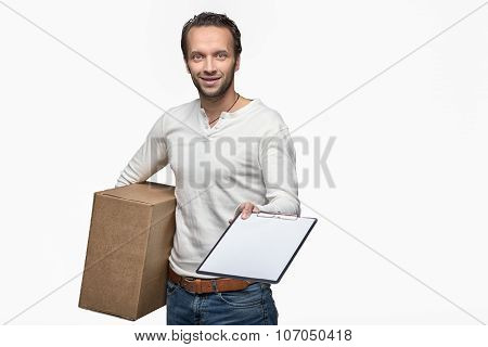 Smiling Male Courier Delivering A Parcel