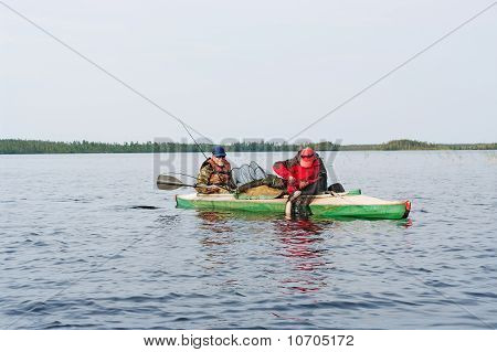 Tourists On A Canoe