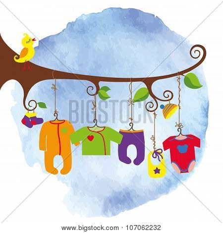 Baby born clothes hanging on the tree.Watersolor sky