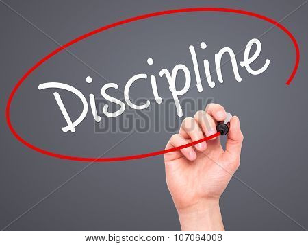 Man Hand writing Discipline with black marker on visual screen.