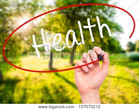 Man Hand writing Health with black marker on visual screen.