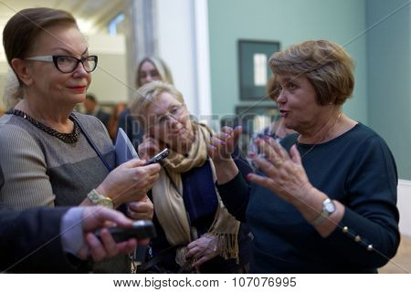ST. PETERSBURG, RUSSIA - OCTOBER 22, 2015: Deputy director of Russian Museum Evgenia Petrova talks with press at the exhibition of Pavel Fedotov, 1815-1852