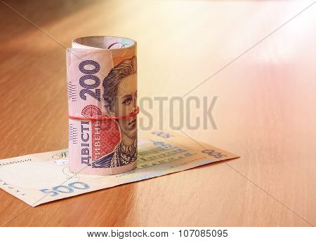 Bank Roll Of Ukrainian Hryvnia On The Table