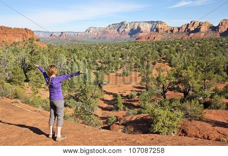 A Woman Rejoices In The Sedona Beauty