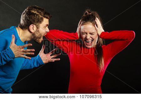 Husband abusing wife. Aggresive man screaming at crying scared woman. Domestic violence aggression. Bad relationship. poster