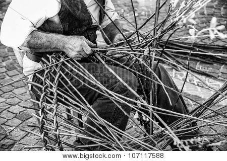 Artisan Builds Wicker Baskets.