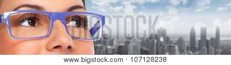 Beautiful woman eyes with eyeglasses. Optician banner background. poster
