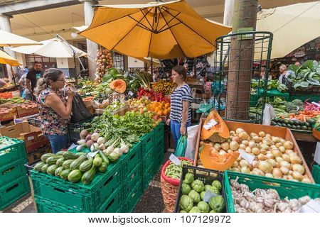 FUNCHAL, MADEIRA, PORTUGAL - JUNE 29, 2015: Bustling fruit and vegetable market in Funchal Madeira on June 29, 2015.