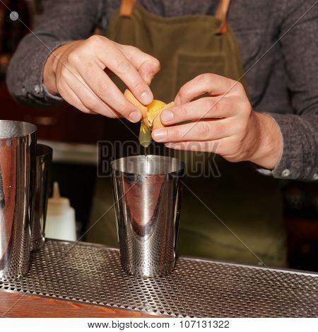 Bartender is adding egg white to shaker to make a flip cocktail