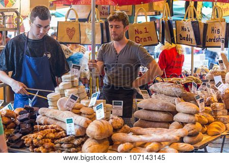 LONDON, UK - MAR 27: Unidentified people purchase bread at a bakery in Borough Market in London on March 27, 2015.