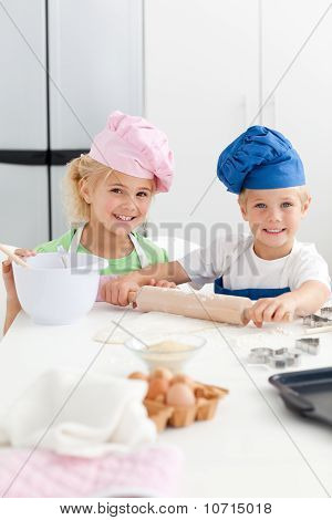 Cute Sibling Baking Cookies Together In The Kicthen