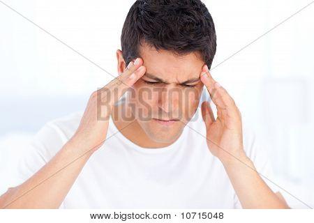 Portrait Of A Sick Man Having A Migraine