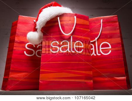 Christmas - Sale bag rebate on wood background