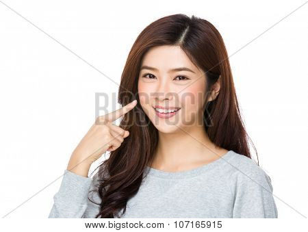 Asian Young Woman with finger point up her teeth