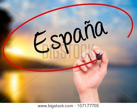 Man Hand writing España (Spain in Spanish) with black marker on visual screen.