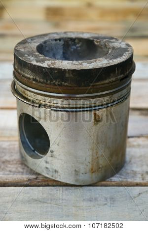 piston of engine on wooden background, Auto parts industry and spare parts background, piston damage in hard works. poster