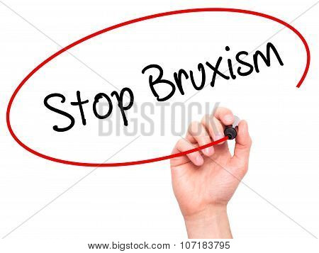 Man Hand writing Stop Bruxism with black marker on visual screen.