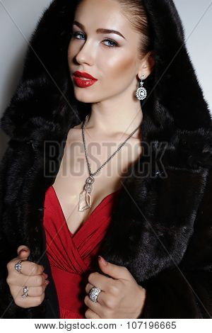 Gorgeous Sensual Woman With Elegant Hairstyle,wears Red Dress And Fur Coat