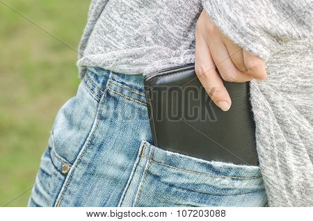 Woman Pulling Out Her Wallet From The Pocket