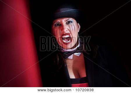 Woman dressed like a circus ring master poster