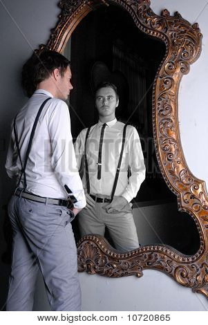 Young good looking male in front of Mirror