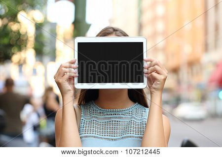Showing A Blank Tablet Screen Covering Her Face