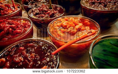 Colorful Pickled Fruits In Vinegar For Sale In A Traditional Iranian Bazaar