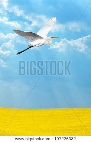 Tropical Crane Over Light Blue Sky Vertical Image