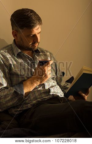 Lorn Man Relaxing With Book