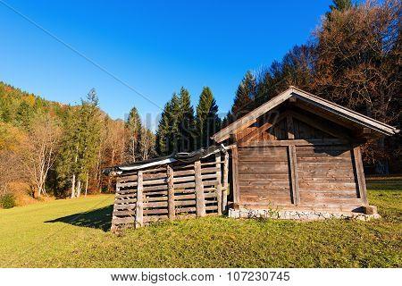 Typical wooden shed in Italian Alps - Val di Sella (Sella Valley) Borgo Valsugana Trento Italy poster