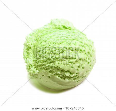 pistachio ice cream scoop close-up isolated on white