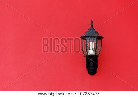 Old Lantern On Red Concrete Wall