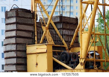 Part Of Crane - Heavy Concrete Slabs For Counterweight On Construction Site
