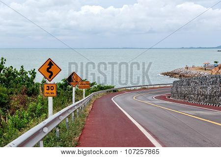 Winding Road With Warning Traffic Sign