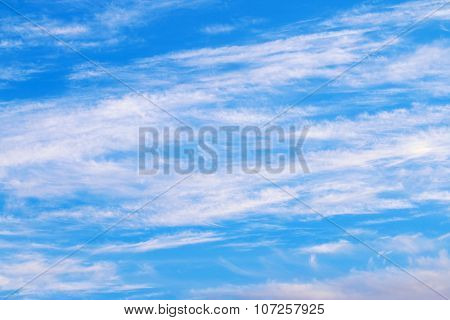 Spindrift White Clouds On Light Blue Clear Sky At Sunny Winter Day