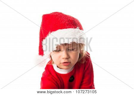 Little Child In Red Santa Hat On White Background. Portrait