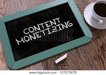 Content Monetizing Handwritten by White Chalk on a Blackboard. Composition with Small Blue Chalkboard and Cup of Coffee. Top View. poster