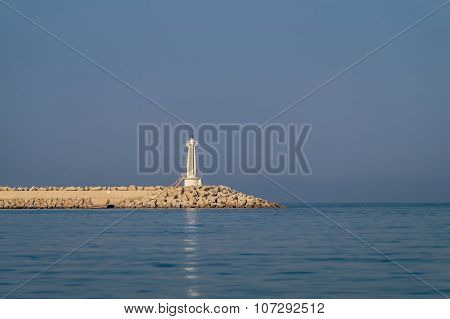 Lighthouse on a long seashore