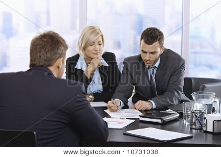 Businessteam Reviewing Documents