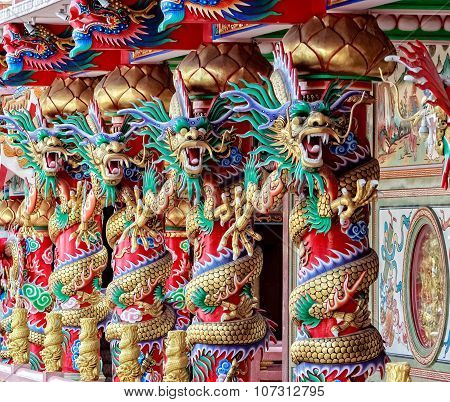 Four Chinese Dragons On Red Pillar