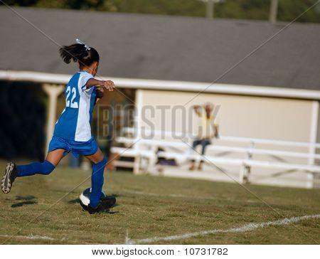 Girl Chasing Soccer Ball
