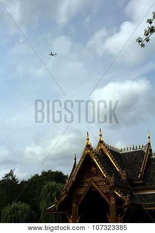 The Image Of The Asian Pagoda And The Plane In The Sky