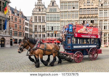 Tourists In A Horsecar Downtown In The Medieval City Antwerp