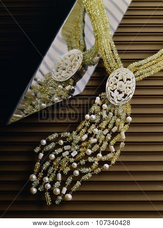 Still life of Emeralds mother of pearl and Pearls Necklace poster