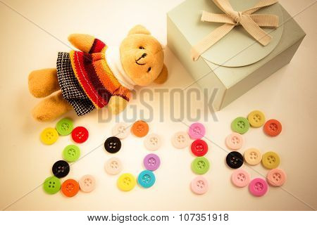 2016 new year is coming, celebrate season to give a gifts. be wish you with lovely bear and a presen