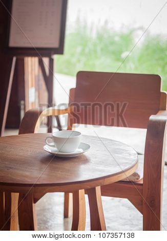 Coffee Cup On Table In Coffee Shop
