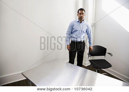 Man Standing In Empty Office