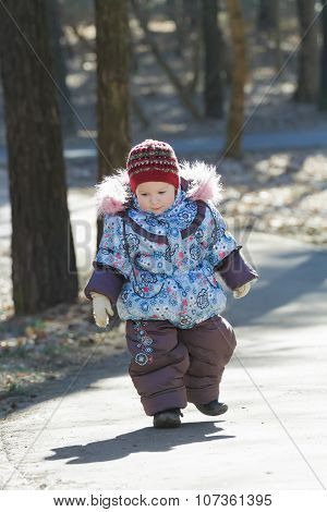 Little Adorable Girl Toddling Without Help In Cold Weather Park