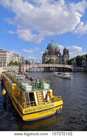 Berlin, Germany - July 26, 2015: Exterior View Of Buildings And A Boat Shipping At The River Spree I